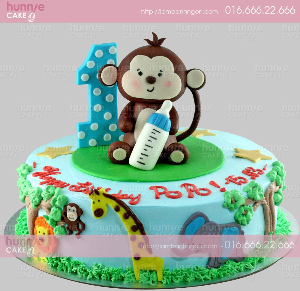 Bánh gato sinh nhật làm hình 3D con khỉ nâu dễ thương 1 tuổi cầm bình